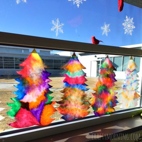 Make beautiful coffee filter christmas tree suncatchers using just coffee filters, markers, and a spray bottle of water! Perfect christmas craft for the classroom.