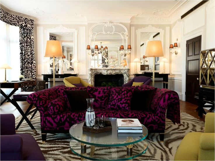 A claridges hotel guest room designed by dvf featuring a funky zebra rug