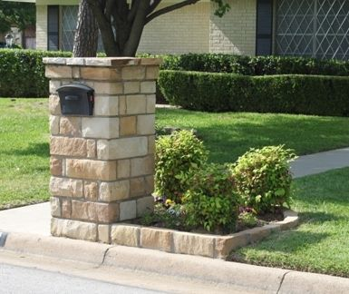Image -- maybe I could use a matching brick to create a rounded garden around the brick mailbox.  Clematis in the back.
