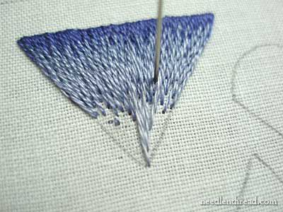 Our objectives in this lesson are to practice stitching long & short stitch to a converging point, keeping the correct stitch direction, and to understand how to reduce the number of stitches in smaller spaces (without bunching up the stitches) in a way that looks (more or less!) natural…NOTE: The technique of the stitch is the same learned in lesson two.  This particular lesson presents two challenges: keeping the stitch direction and reducing the number of stitches as the space gets…