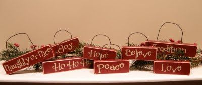 Christmas craft - wood with vinyl letters - http://andyandjessicaolsen.blogspot.com/2009/12/december-09-craft-group.html