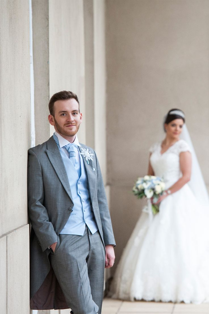 groom in grey slim fit wedding tailcoat with pale blue cravat  Sleigh bells ring: Luisa and Ronan's winter wonderland wedding - Real Weddings | Easy Weddings UK