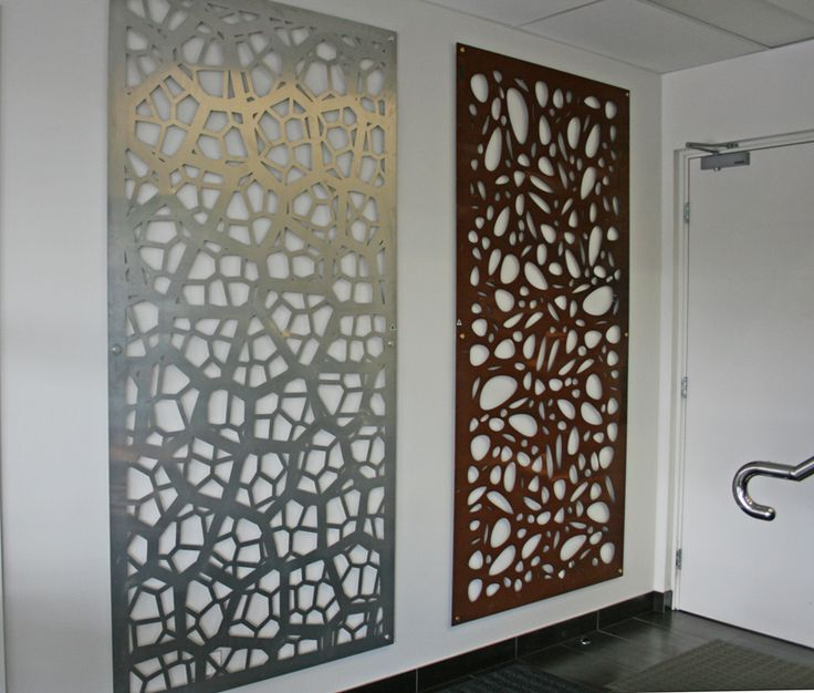 Large stunning decorative screens line the reception walls of our headquarters. The one on the left is 'Pretoria' in raw aluminium, the right is 'Cayman' in corten. ~QAQ