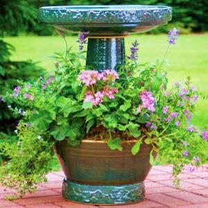 Beautiful hand glazed finish birdbath with flower ring. Great focal point for any garden. Locking birdbath top. Planting tubular flowers will attract nectar feeding hummingbirds.