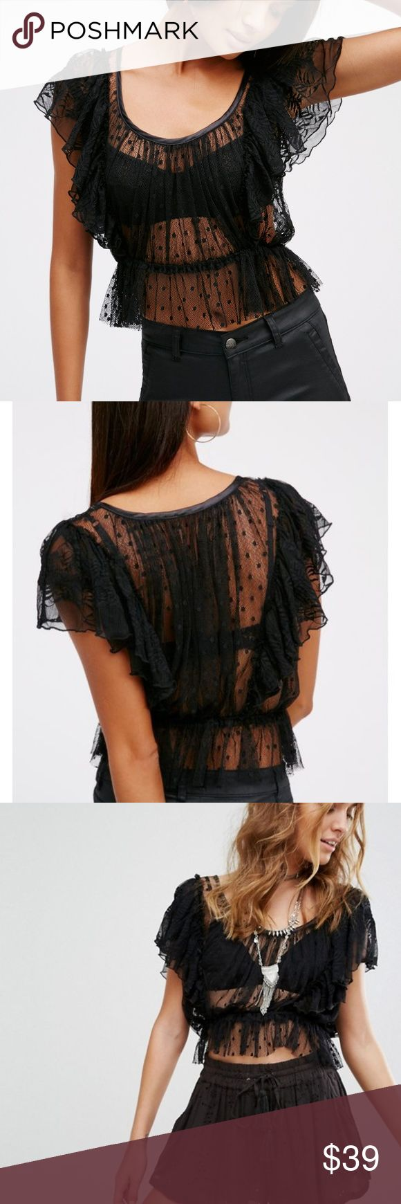 "Free People Sweet Surprise Top The sweetest sheer top featuring a mesh fabrication with a lacey design and darling dots throughout. Femme ruffles along the sleeves and a silky trim along the scooped neckline. Elastic at the waist for a defined silhouette.  In excellent condition. Fits true to size- Length is 16"". No trades, please! Offers welcome. Free People Tops Blouses"