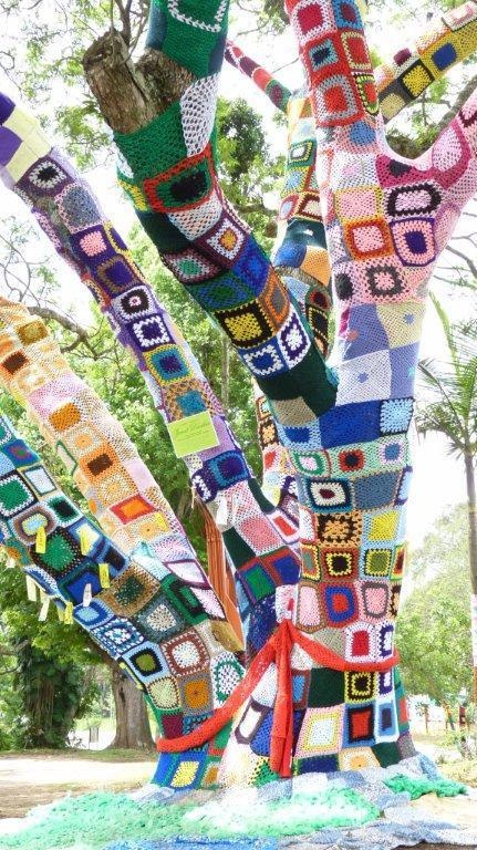 Yarnbomb tree at the Hillcrest Aids Centre in South Africa - made up of granny squares. #yarnbombtree #aidscentre