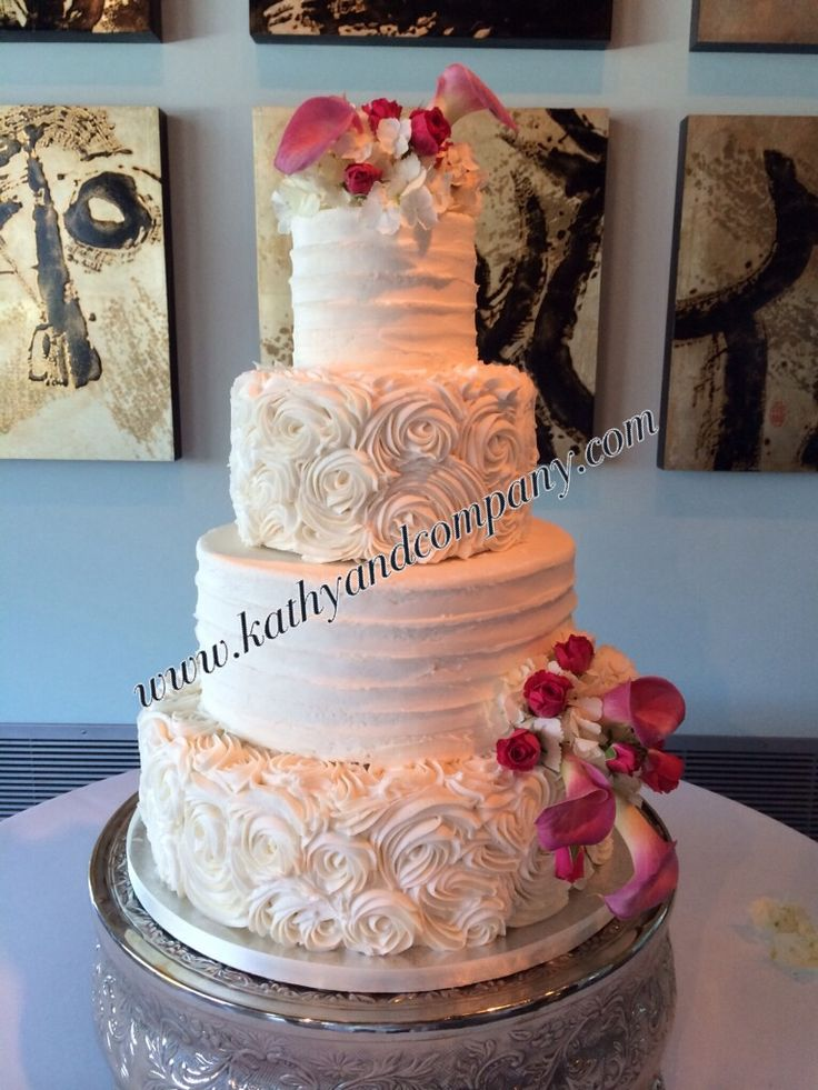 Buttercream rosettes and horizontal lines wedding cake