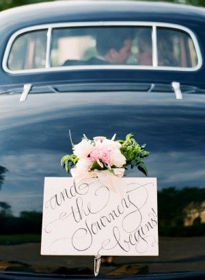 Vintage getaway car with the sweetest sign |  floral design by http://www.patsfloraldesigns.com/ | styling by http://justalittleditty.com/ | photography by http://www.jenfariello.com/