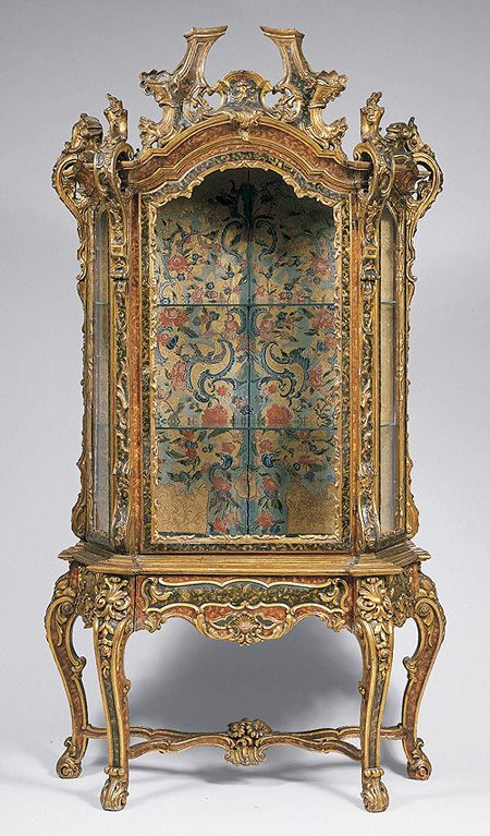Rococo cabinet the heavy embellishment and gold almost for French baroque characteristics
