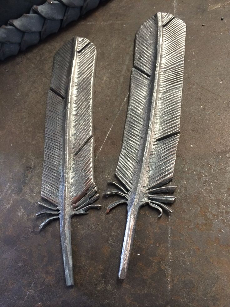 Ironton Forge- Hand forged feathers for a chandelier.