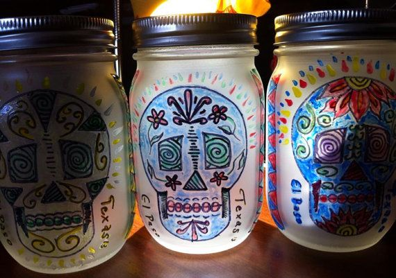 These are Decorative Dia De Los Muertos themed mason jar lanterns with recharchable solar LED lids but I am going to put a different design on them....looks like an awesome idea!