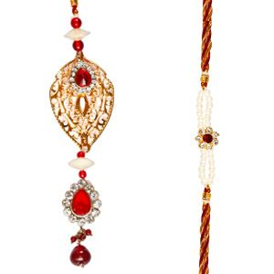 Bhaiya Bhabhi Rakhi Set: Set of rakhi and lumba for Bhaiya & Bhabhi. The lumba (rakhi for Bhabhi) is studded with white diamond and red stones with red pearls dangling at the bottom. The golden design at the center gives a glamorous look to this lumba. It has a matching single diamond & pearl rakhi for the brother. Costs rs 785/- http://www.tajonline.com/rakhi-gifts/product/rdr70/bhaiya-bhabhi-rakhi-set/?aff=pinterest2013/