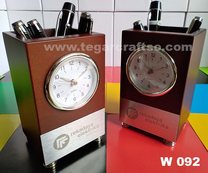 W092: An elegant design wooden analog desk clock plus pen holder as a timepiece and to put a stationery on your work table. It's a powerful promotional tool to your clients, or prospects they will continously to remind you because a branding of your company logo at the bottom of the desk clock. Ideal to use construction companies souvenirs. Appeared picture a deskclock ordered by PT Rekadaya Konstruksi, a power plant construction contractor company located in Jakarta Indonesia.
