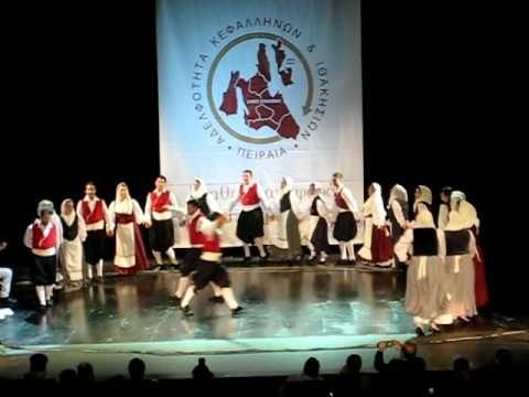 Kkefalonia dance video. Men wear red vests, black vraka, white or ivory leggings and sash. The colors of the women's costume vary.
