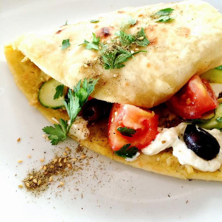 New Breakfast Option: Labne and hummus on flatbread with cucumber, tomato and olives.  www.themilkandhoney.co.nz