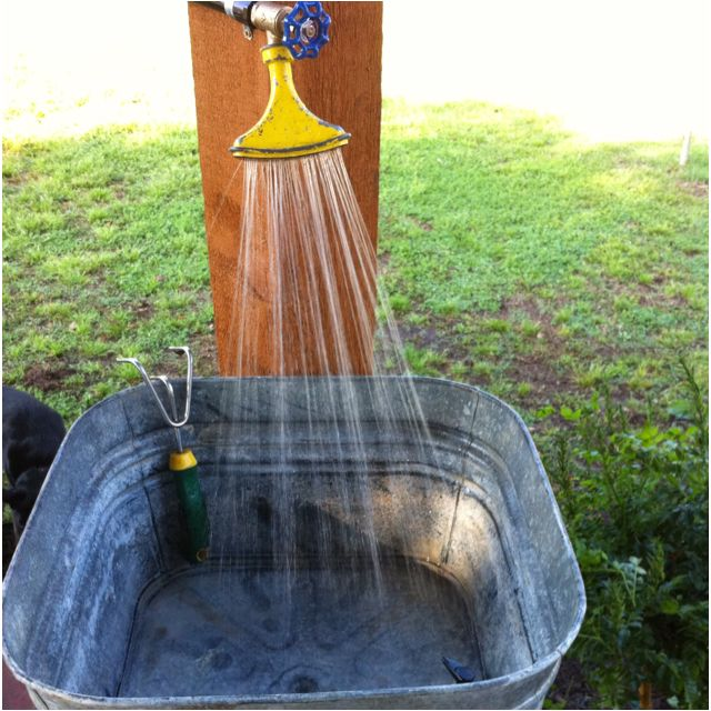 Outdoor sink made from vintage washtub - with fan spray nozzle for faucet.