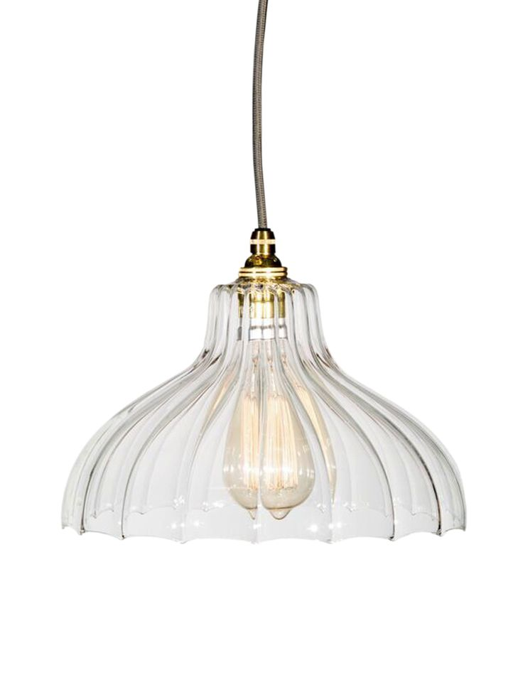 Beautifully handcrafted in the UK, our ribbed glass parasol pendant lights are individually hand blown and crafted by local craftsmen. Each glass shade is made from the highest quality glass, with soft ribbed detail and scalloped edges, and reflect light beautifully across a room. The Fluted Glass Factory Pendant is finished with brass fittings and ceiling rose, and a grey fabric flex. Also available in a Tulip or Dome shape. Click here to view our useful lighting buying guide.