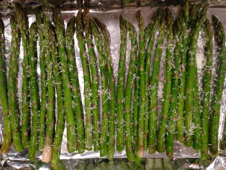Easy Oven Roasted Asparagus: 1. Place fresh asparagus in bowl. Toss with olive oil, salt & pepper, garlic, and Parmesan 2. Preheat an oven to 425 degrees, spread asparagus on baking sheet and bake for 12-15 minutes