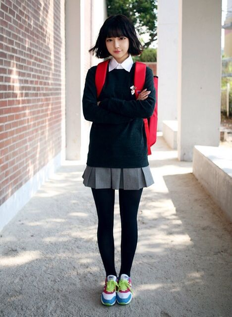 Korean girl's school uniform.  I would like that as a uniform, its has a simple stylishness.