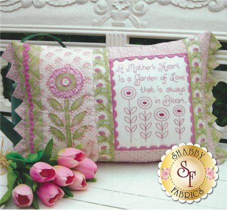 """The Rivendale Collection - A Mother's Heart: This whimsical pattern is a part of The Rivendale Collection by Sally Giblin. Pattern includes instructions for stitchery, instructions for appliqué, and instructions for cushion. Finished size is 14"""" x 22 1/2"""".Hand embroidered verse reads:: """"A Mother's heart is a garden of love that is always in bloom."""""""