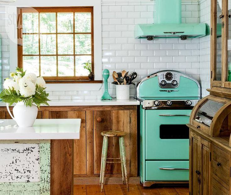 Retro-style kitchen with mint-hued appliances {PHOTO: Donna Griffith}