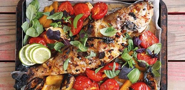 Marinated grilled fish with tomato and mango salsa