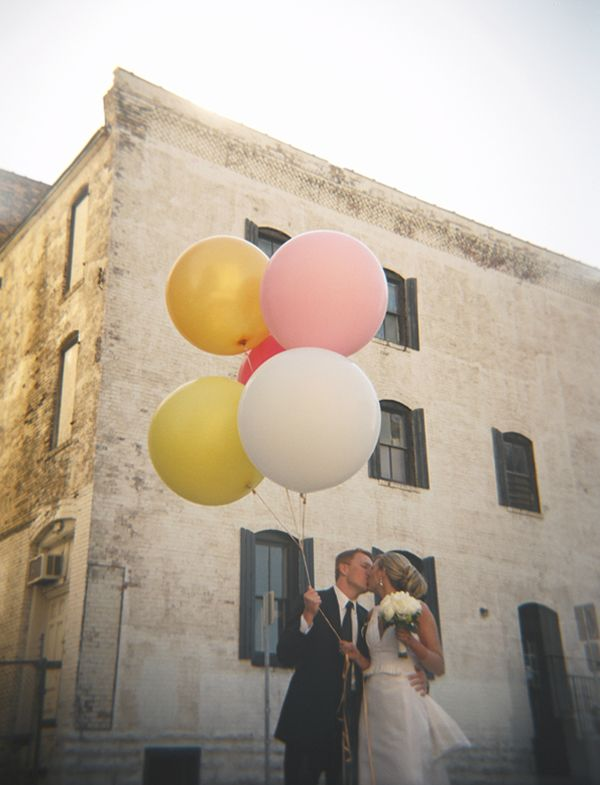 cute wedding picture - maybe release balloons at ceremony instead of stinky doves.