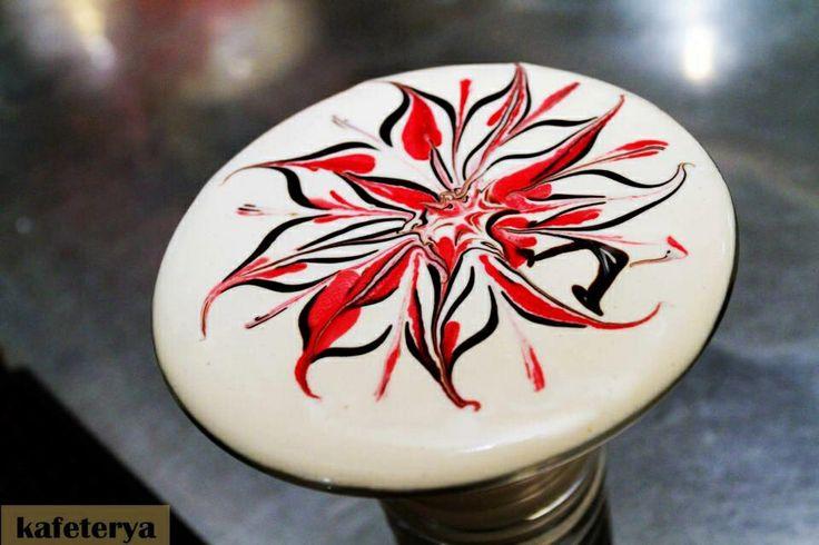 Latte art red flower