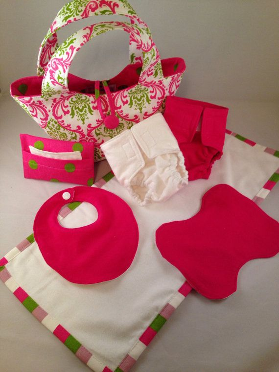 Introducing the Mommy & Me set. This is a baby doll diaper bag, 2 cloth diapers for baby doll, 1 mini burp rag and 1 bib, 1 wipes case, 5 wipes, and 1 changing pad. This is the same design as the bigger Mommy Bag you have grown to love, only this is sized for your little girl. Now she can feel just like mommy with her very own diaper bag. These cloth diapers are designed to fit a 10-18 baby doll and have velcro all the way across the front of the diaper to allow for more options in tummy…