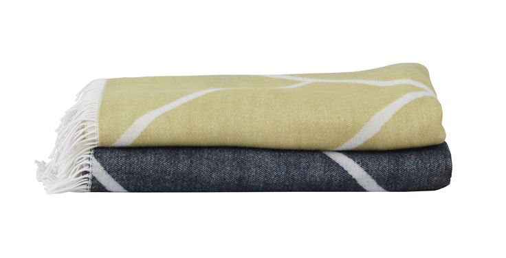 Mesch is by Lassen's new throw with a graphic pattern drawn by Mogens Lassen. It comes in navy and mustard and is fabulously light. Made of Peruvian highland wool.