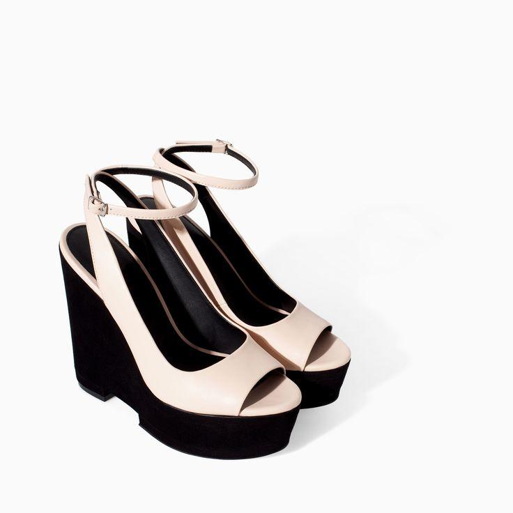 WEDGE WITH ANKLE STRAP - Shoes - TRF - SALE | ZARA Canada Ref. 7360/301 69.90 CAD UPPER 100% POLYURETHANE LINING 100% POLYURETHANE SOLE 100% VULCANIZED RUBBER