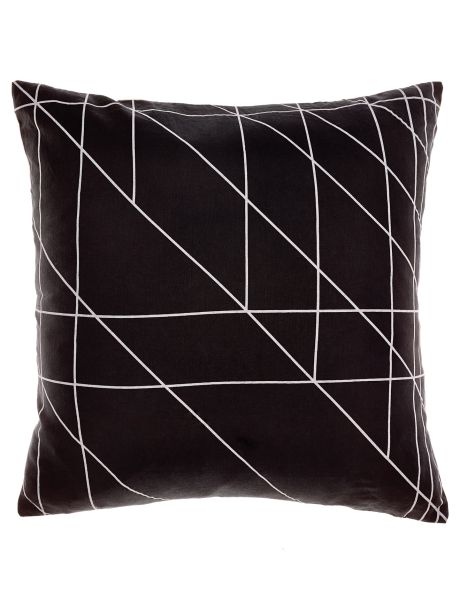 This reversible cushion features white oblique outlines on black, with a grounded peach print on the opposite side.