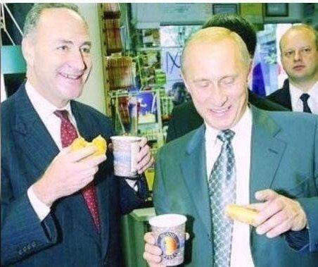 A couple guys having coffee & Krispy Kreme donuts in NYC