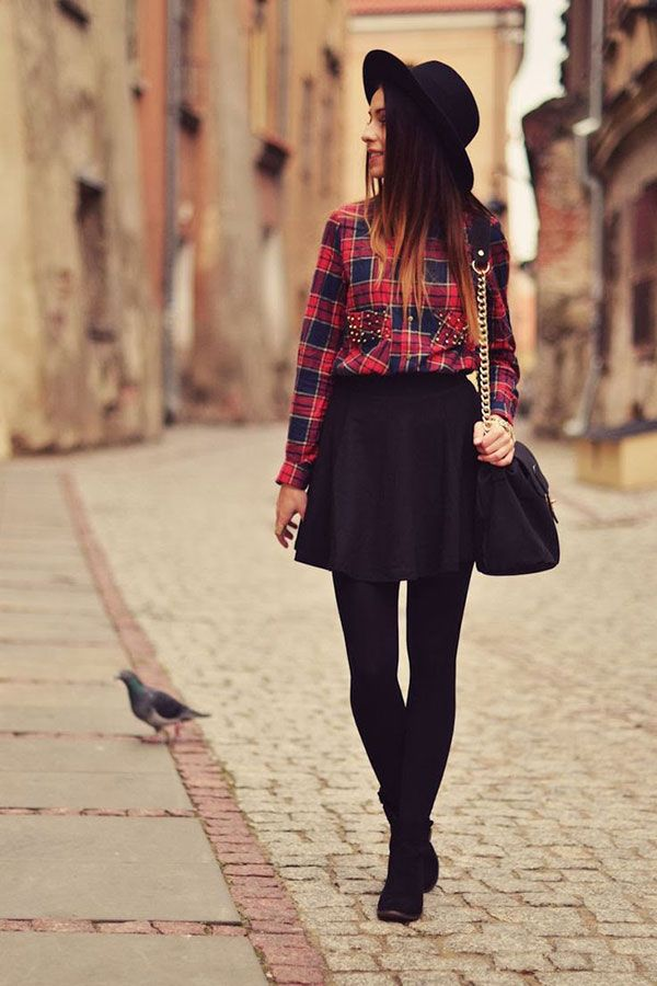 Long sleeves and skirts are definitely what fall fashion is all about. Pair up your favorite checkered long sleeved shirt with a cute black short skirt and leggings. Complete the wonderful look with a pair of short boots.