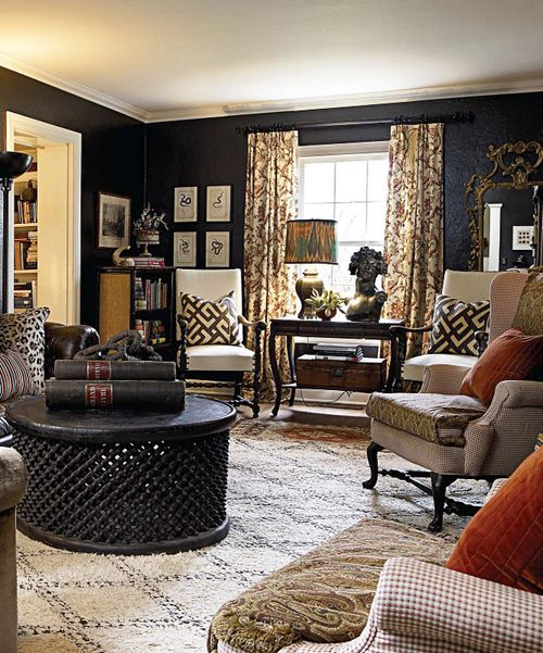 Eclectic living room with black walls and a Beni Ourain rug