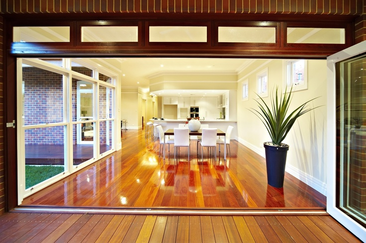 Looking in from the alfresco area across the dining thru to the kitchen. Beautiful polished jarrah floorboards are a key feature.