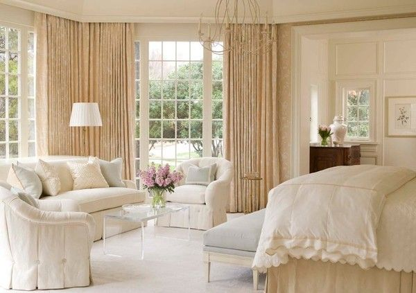 Furniture in large bedroom to create seating space