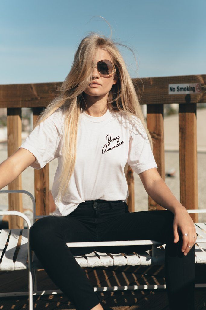 - Young American Tee - Available in Vintage White with black graphics. - 50% Polyester/ 50% Cotton - Sizes S, M, L - Made in USA