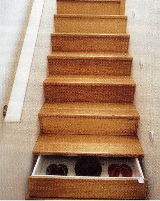 Storage in Stairs - Definitely a good idea.