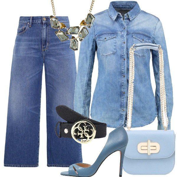 Un paio di jeans cropped ed una camicia di jeans delavè accompagnati a décolleté color cielo, tracolla in tinta ed infine una collana con grandi pietre e cintura Guess nera accompagneranno con stile e freschezza le tue curve.