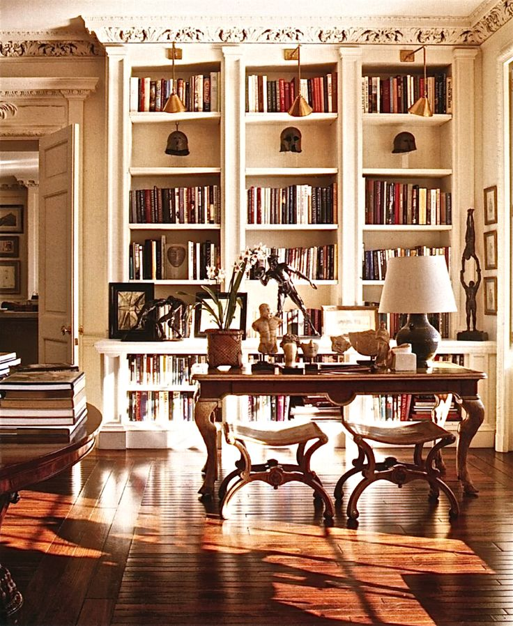 New York apartment of Bill Blass - handsome bookshelves with lighting