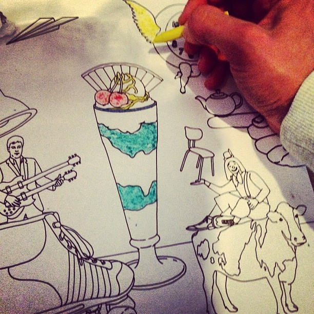 Mika coloring his Artwork