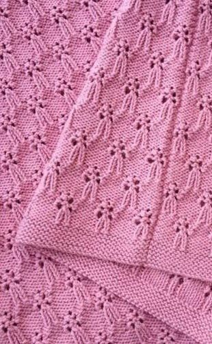 I don't know what to call this stitch, it looks a little like people with their arms akimbo, or some bows. Either way, this link has three pics, one of them is a chart.  Have fun with it!