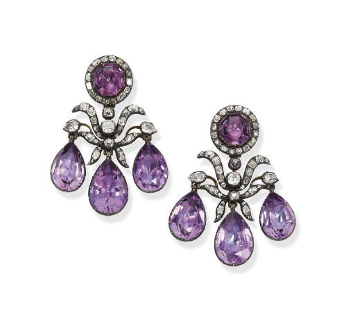 A historic pair of 18th century Amethyst and Diamond ear pendants. Of girandole design, each set with three pear-shaped amethyst drops to the diamond foliate motif and octagonal amethyst and diamond cluster surmount, mounted in silver and gold, circa 1760. Christies.