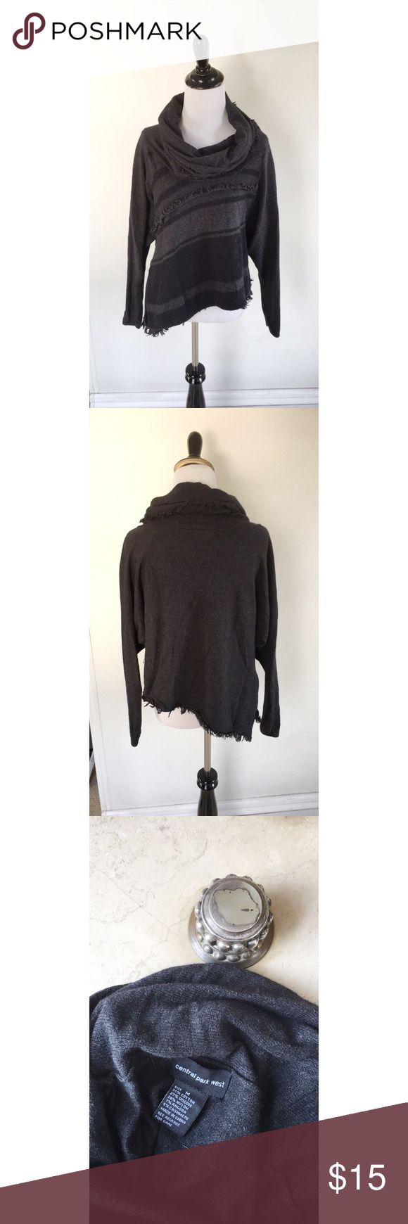 FINAL SALE! Central Part West Sweater Size M. Grey & Black. Goes diagonal and is sort of cropped w/fringe detailing. Light lint pilling & the small whole in the back are the only visible flaws I see (see photos) Central Park West Sweaters