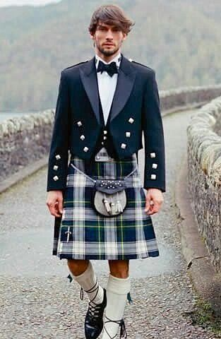 Man Wearing the Dress Gordon in Dark Navy Colour of its Kilt.
