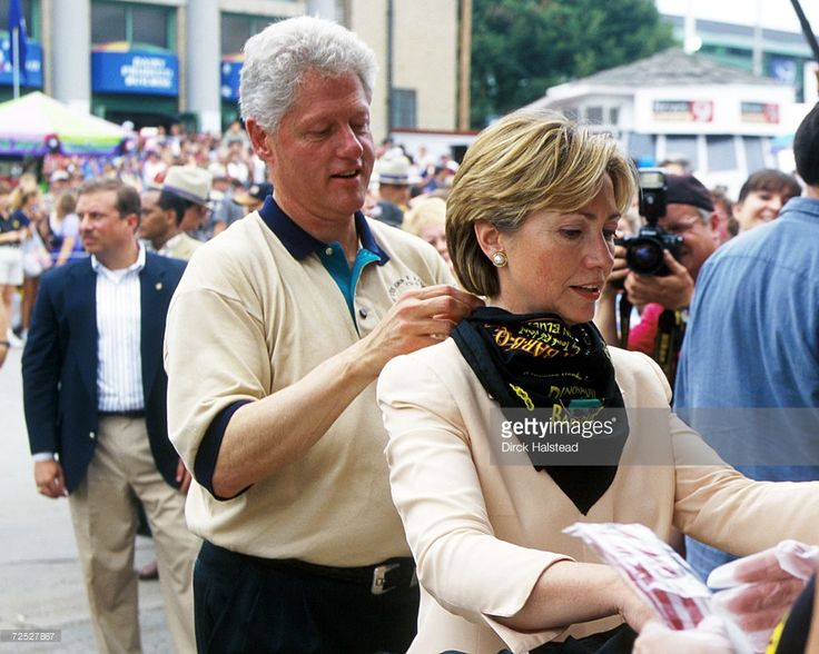 Bill Clinton girlfriends | President Bill Clinton helps his wife Hillary Clinton with a bandana ...