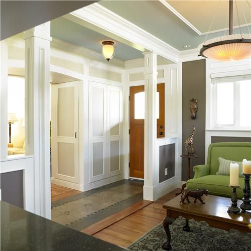 Define territory - Don't skip the foyer. There's something mildly disconcerting about stepping from the outdoors directly into someone's living room. A designated foyer area creates a sense of place & a smoother transition into your home. Even this modestly sized Craftsman makes way for a small foyer by using a pair of half walls & columns to clearly define the entry without confining it. The door to the coat closet just around the corner prevents congestion as guests arrive. Foyer by Ines…