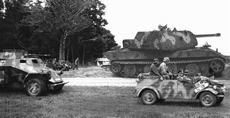 Panzerkampfwagen VIII Maus (Mouse) was a German World War II super-heavy tank completed in late 1944. It is the heaviest fully enclosed armoured fighting vehicle ever built. In this photo in the background is the E-100, another experimental Super Heavy Tank in development at the same time as the Maus.
