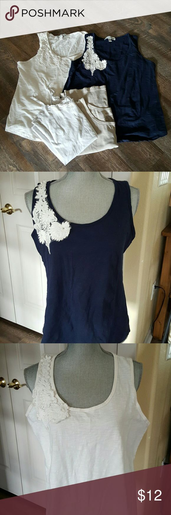 Bundle of tank tops Blue and white tank top have a flower embroidered applique on the right shoulder.  Size XL flowy fit. 100% cotton.  Made by French Laundry.    White cami has lace around the neckline and waist. Form fitting for the perfect layering look. Size L by Romy. Does not have a material tag.  Beige ribbed tank is size XL by St. Johns Bay. True to size and comfortable.  That perfect color that pairs well with other colors.  Bundle discount available. Nonsmoking home. All reasonable…